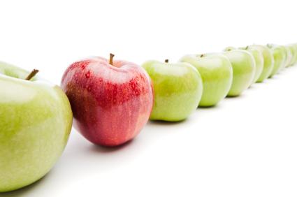 Red Royal Gala apple among Granny Smith green apples